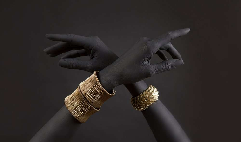 Black woman's hands with gold jewelry