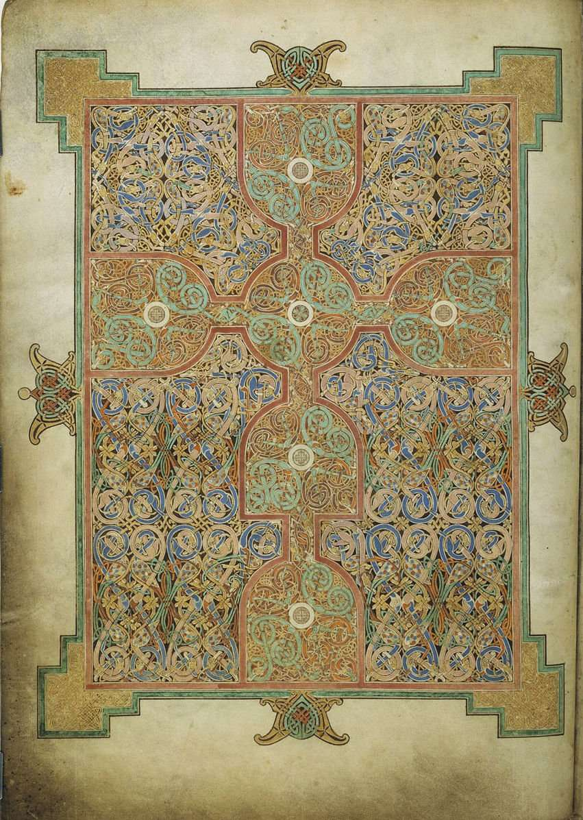 Carpet page from the Lindisfarne Gospels with stylised cross and colourful knot work.